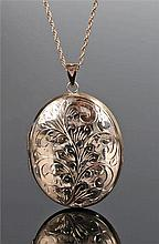 9 carat gold locket and chain, the foliate decorated locket with internal l
