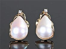 Pair of 9 carat gold pearl and diamond set earrings, the pear shaped pearl