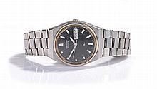 Seiko stainless steel gentleman's wristwatch, the signed black dial with ba