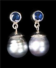 Pair of platinum sapphire and pearl earrings, the circular grey pearls at a