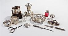 Collection of silver, to include silver capped bottles, napkin ring, a dish