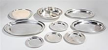 Silver plated dishes, to include three serving platters, a cheese board, a