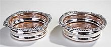 Pair of 19th Century silver plated coasters, with shell and arched gadroone