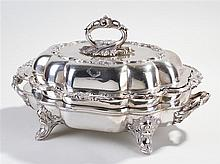 Silver plated entrée dish, the acanthus leaf handle above a shaped cover wi