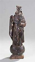 18th Century carved figure of a Saint, with one arm raised with long robes