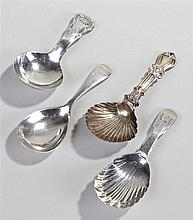 Four silver caddy spoons, to include a Victorian Irish silver shell bowl ca
