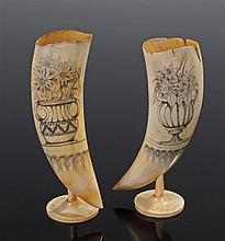 Pair of 19th Century scrimshaw whales teeth, the engraved pen work decorati