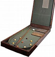 Mahogany box containing Bar Billiards, a cue and nine balls. closed box 91x