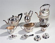 Silver plated teapot on stand, the gadrooned teapot above a base with burne