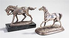 Two silver plated models of horses, one with a saddle attached and the lett