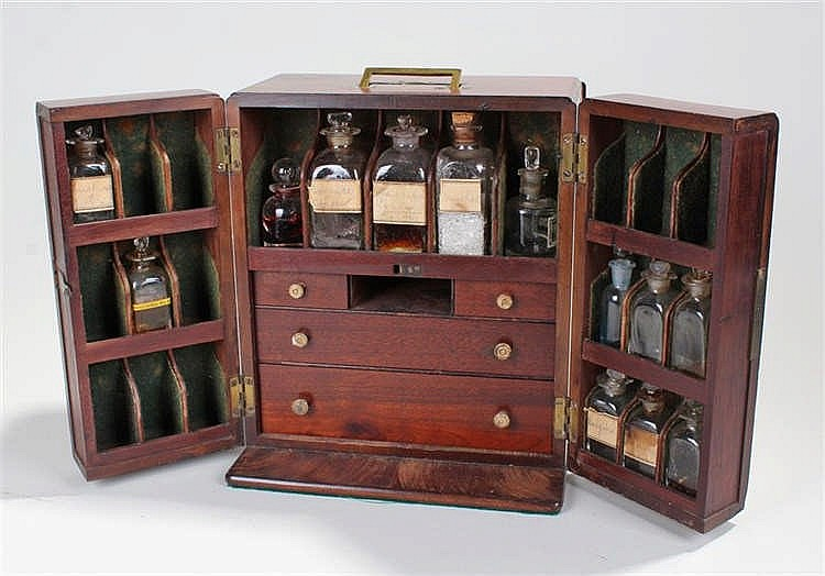 Early 19th Century mahogany apothecary cabinet, the sunken brass handle to