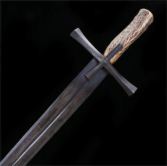 Broad sword double edged with single fuller and cruciform quillons, later g