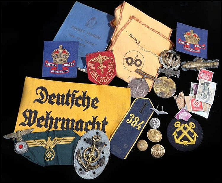A tin containing a Third Reich Deutche Wehrmacht arm band, together with a