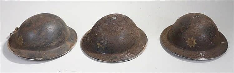 Three World War II Suffolk & Ipswich Fire Service helmets, some with origin