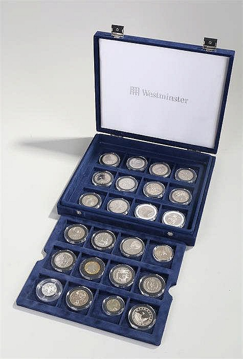 Collection of twenty four Russian silver and silver-gilt coins, all capsule