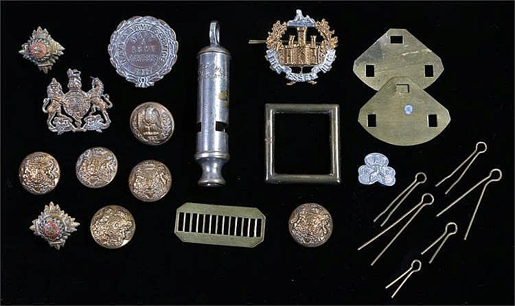 Quantity of World War One cap badges, buttons and an Acme Scout Master whis