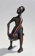 African carved figure, with long arms playing a drum, 34cm high - Stock Ref