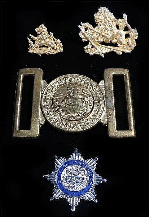 Rhodesian British South African Police locket union, together with a BSAP c
