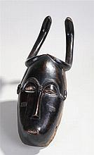 Fine African Guro mask, with snake head above zigzag eyebrows painted eyes
