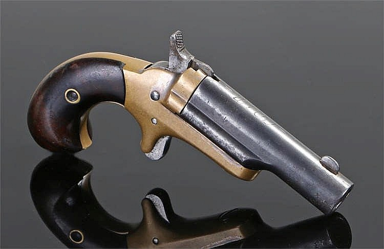 Circa 1875 Colt rim fire Derringer third model with plain wood grip lower s