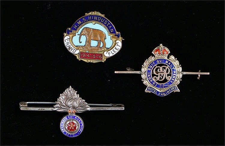 Military badges, to include a 9 carat gold Royal Engineers badge, HMS Hindu