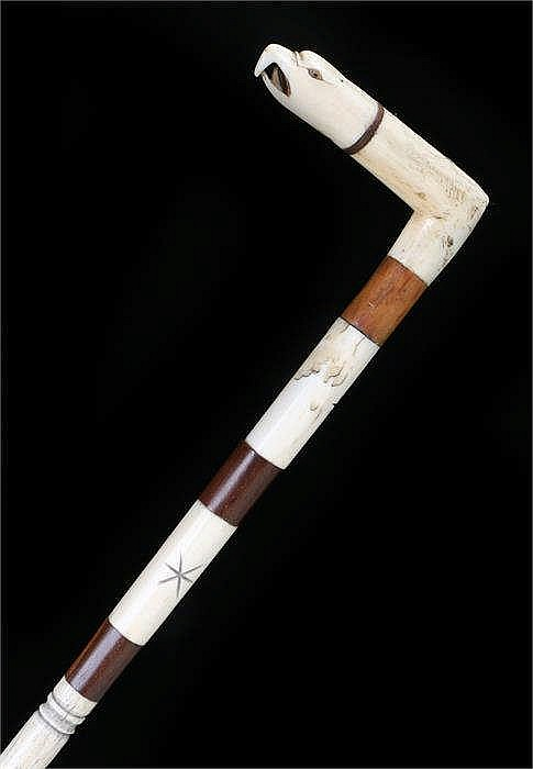 George III whale bone walking stick, the eagle head carved top above a star