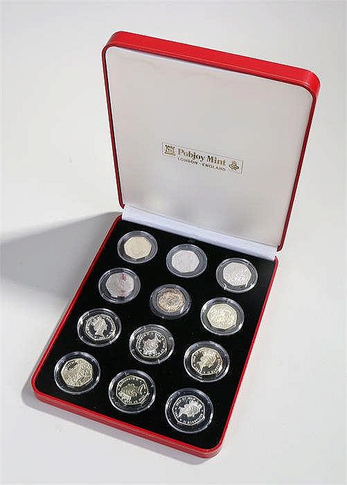 Pobjoy mint Christmas 50 pence set, twelve coins in capsules, cased, (12) -