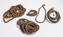 Quantity of African metal necklaces and armlets, the two armlets with label