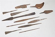 Twelve early 20th century African iron spear HEADS, arrow heads and a knife