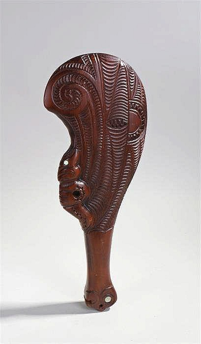 Maori Wahaika paddle club, of typical form, carved with arched bands, 36cm