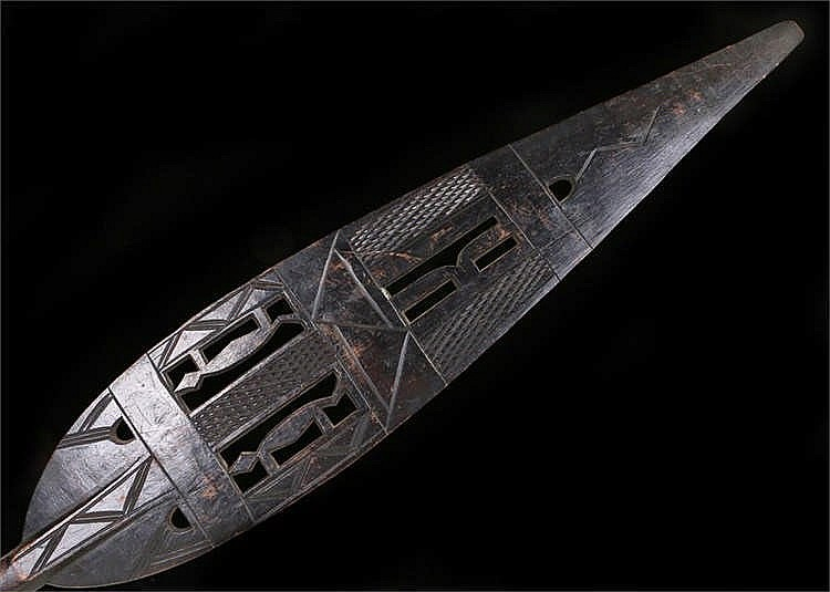 West African paddle with pierced blade crudely carved with stylised animals