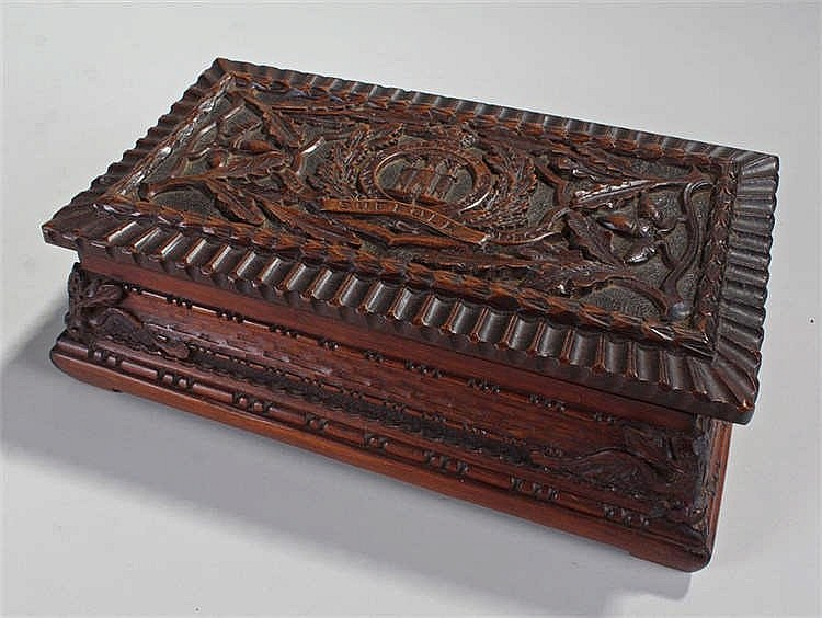Suffolk Regiment, a carved cigar box, with the Suffolk crest and acorn bran