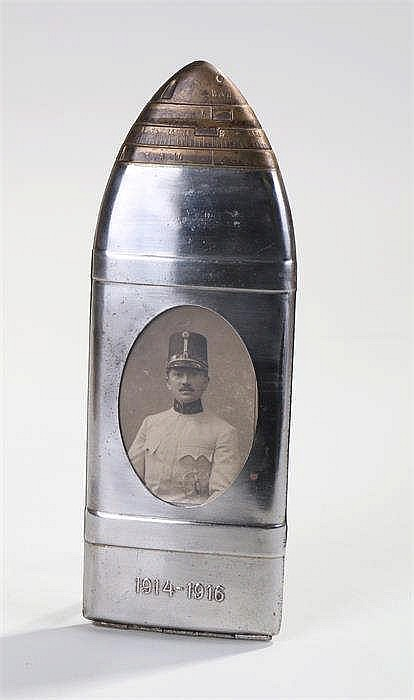 Unusual World War One commemorative frame in the form of an artillery shell