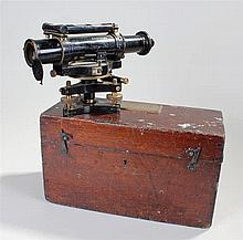 Cased theodolite, the black lacquered body with brass fittings - Stock Ref:
