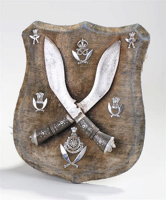 Of Gurkha interest, crossed kukri mounted on a shield shape board with Gurk