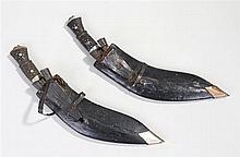 Two Kukri's, both with steel blades and leather scabbards with attached sma