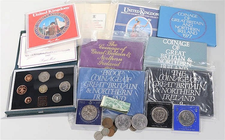 Great Britain cased coin sets consisting of 1977, 1979-1986, two cased Char