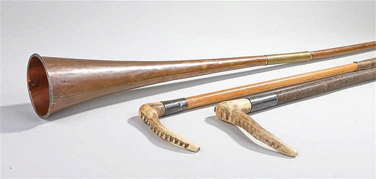 Two antler handle silver mounted hunting whips with plaited leather whips.