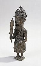 Nigerian bronze depicting a figure wearing a crown and holding a sword  - S