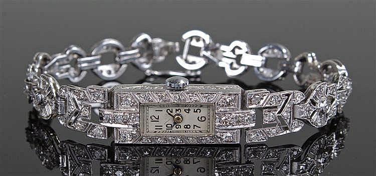 18 carat gold diamond set ladies wristwatch, the rectangular dial with Arab