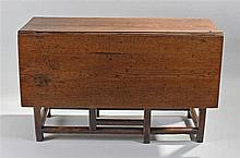18th Century oak gate leg table, the drop sides above frieze drawers to eit