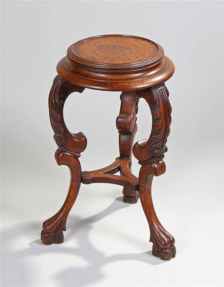 Victorian oak stand, the circular top above acanthus leaf carved scroll leg