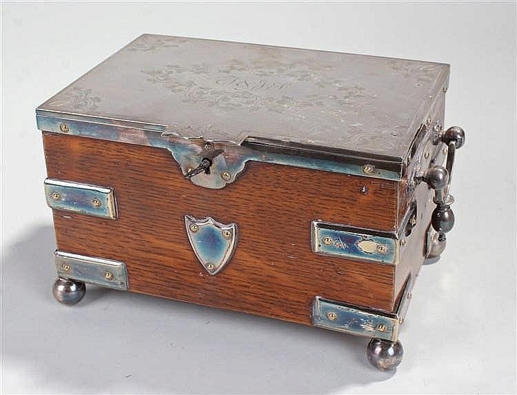 Victorian silver plated and oak tea caddy, in the form of a strapped chest