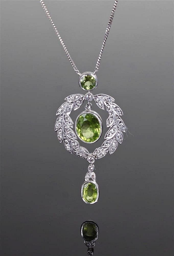 18 carat white gold and peridot pendant, the pendant with three peridots an