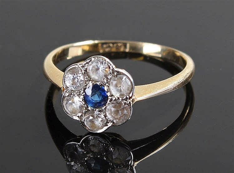 18 carat gold paste and sapphire ring, the central sapphire surrounded by p