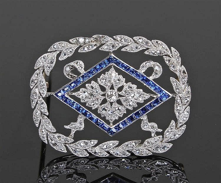 Diamond and sapphire brooch, the brooch with a central flower, diamond shap