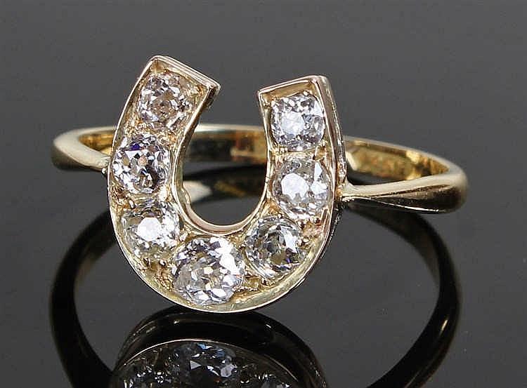 Fine 18 carat gold, diamond set, horse shoe ring, set with eight diamonds t