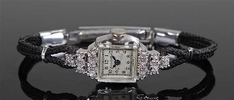 Bulova ladies 14 carat white gold and diamond set wristwatch, the square si