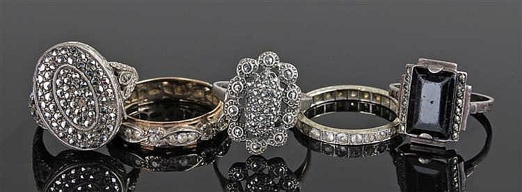 Five rings, to include a 9 carat gold eternity ring, a 9 carat white gold e