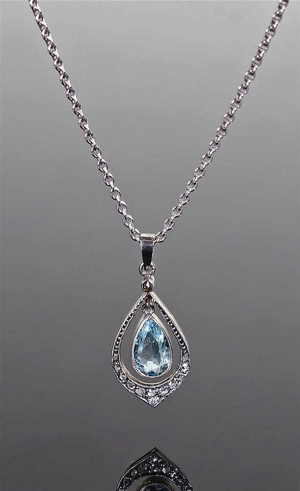 Diamond and aquamarine pendant, the pendant with a pear cut aquamarine surr
